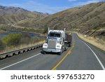 semi truck driving on mountain... | Shutterstock . vector #597653270