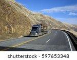 semi truck driving on mountain... | Shutterstock . vector #597653348