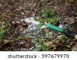 water coming out of rubber tube | Shutterstock . vector #597679970