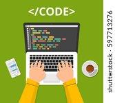 programmer coding on laptop... | Shutterstock .eps vector #597713276