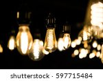 vintage light bulbs hanging in... | Shutterstock . vector #597715484