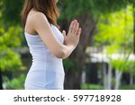 young people training yoga and... | Shutterstock . vector #597718928