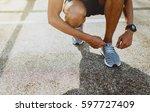 runner men trying running shoes ... | Shutterstock . vector #597727409