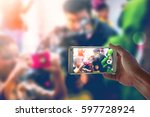 person is taking video with a... | Shutterstock . vector #597728924
