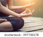 close up hand. woman do yoga... | Shutterstock . vector #597730178