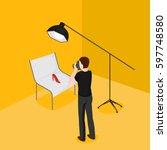flat isometric man taking... | Shutterstock .eps vector #597748580