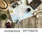 travel concept on wooden table | Shutterstock . vector #597796070