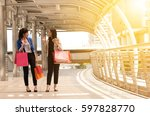 two young business women with... | Shutterstock . vector #597828770