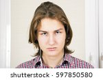 portrait of the sad  young man  ... | Shutterstock . vector #597850580