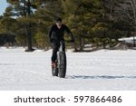 Male Rider Winter Cycling On A...