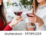 Two female friends drinking...