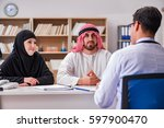 doctor consulting arab family... | Shutterstock . vector #597900470