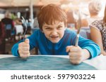 little child boy hungry waiting ... | Shutterstock . vector #597903224