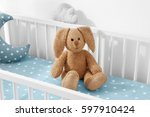 cute soft bunny toy in baby crib | Shutterstock . vector #597910424