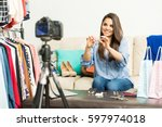 cute young female vlogger...   Shutterstock . vector #597974018