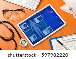 Stock photo vital signs in tablet screen medical technology concept various medical equipments 597982220