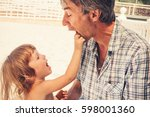 a small curly girl and her... | Shutterstock . vector #598001360