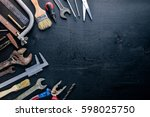 old working tools on a dark... | Shutterstock . vector #598025750