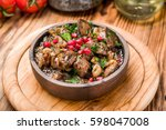 roasted meat with vegetables on ... | Shutterstock . vector #598047008