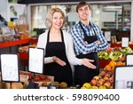 friendly sellers posing with... | Shutterstock . vector #598090400