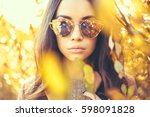 outdoor fashion photo of young... | Shutterstock . vector #598091828
