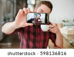 smiling young man taking selfie ... | Shutterstock . vector #598136816