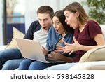 three amazed friends watching...   Shutterstock . vector #598145828