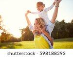 happy mother with daughter... | Shutterstock . vector #598188293