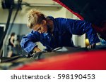 female mechanic fixing a red... | Shutterstock . vector #598190453