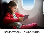 adorable little girl traveling... | Shutterstock . vector #598207886