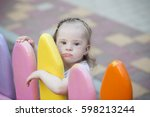 beautiful little girl with down ... | Shutterstock . vector #598213244