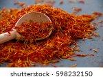 saffron in a spoon on a dark... | Shutterstock . vector #598232150