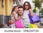happy daughters hugging father... | Shutterstock . vector #598234724