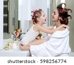 young mother and daughter in... | Shutterstock . vector #598256774