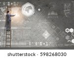 businessman climbing ladder in... | Shutterstock . vector #598268030