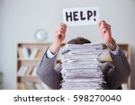 businessman busy with paperwork ... | Shutterstock . vector #598270040