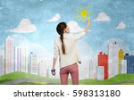woman painting wall in colors . ... | Shutterstock . vector #598313180