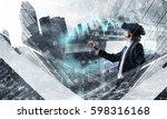 man in virtual helmet . mixed... | Shutterstock . vector #598316168