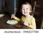 cute toddler boy eating sausage ... | Shutterstock . vector #598327784