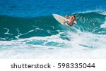 riding the waves. costa rica ... | Shutterstock . vector #598335044