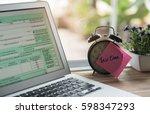 tax time post it on alarm clock ...   Shutterstock . vector #598347293