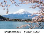 mount fuji with cherry blossom... | Shutterstock . vector #598347650