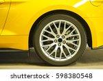 tire of a yellow modern sport...