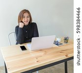 pretty woman working at office  ... | Shutterstock . vector #598384466