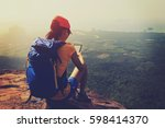 successful woman hiker reading... | Shutterstock . vector #598414370