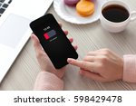 women hands holding phone with... | Shutterstock . vector #598429478