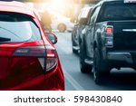 cars on the road heading... | Shutterstock . vector #598430840