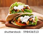 pita salad with roasted chicken ... | Shutterstock . vector #598436513