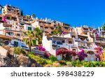 mediterranean houses at the... | Shutterstock . vector #598438229