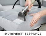 dry cleaner's employee removing ... | Shutterstock . vector #598443428